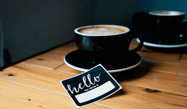 cup of coffee and hello sticker