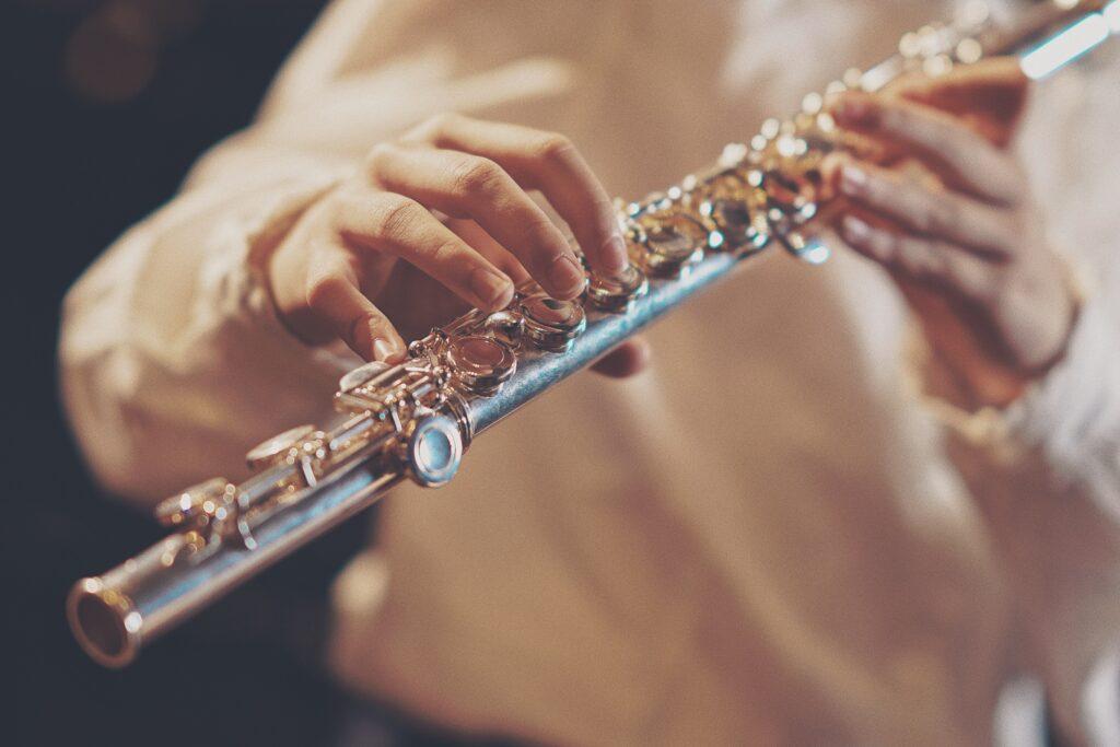 a man holding a brass musical instrument